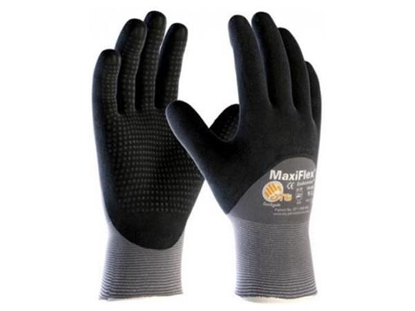 Luva de segurança tricotada em fios de nylon e elastano recoberto com nitrílico espumoso.
